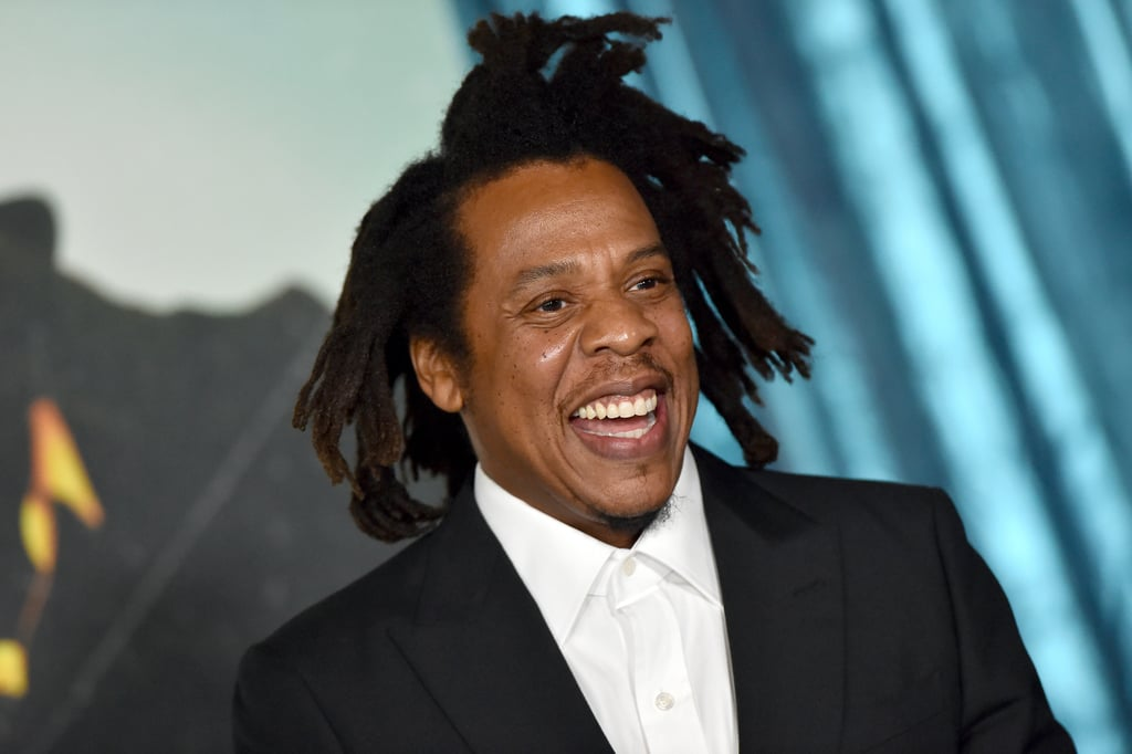 """JAY-Z was front and centre at the star-studded screening of his upcoming film The Harder They Fall in Los Angeles on 13 Oct. The premiere brought out a bunch of famous faces — including Winnie Harlow, Karrueche Tran, Kehlani, and, of course, his wife, Beyoncé — but he clearly had no idea Kelly Rowland would be in attendance, because he had the cutest reaction when he spotted her on the red carpet. Netflix's official Twitter account shared a clip of the sweet moment, showing JAY-Z's genuine surprise at seeing his friend. """"I didn't even know you were here,"""" he told Kelly as he gave her a big hug. In a recent Instagram Live, Kelly reacted to the now-viral moment, saying she didn't understand why it was such a big deal since she and JAY-Z see each other all the time. """"Some things I will never understand,"""" Kelly said. """"I see my big bro all the time, but I guess you guys never see what we see? I don't know."""" The Harder They Fall is a Black Western starring Idris Elba, Jonathan Majors, Zazie Beetz, Delroy Lindo, LaKeith Stanfield, Danielle Deadwyler, Edi Gathegi, R.J. Cyler, Damon Wayans Jr., Deon Cole, and Regina King. JAY-Z is a coproducer along with James Lassiter, Lawrence Bender, and G. Mac Brown. While speaking with Entertainment Tonight, JAY-Z said he hopes the film shows viewers the importance of representation. """"I love to be apart of projects that widen the lens,"""" JAY-Z said. """"Once it's widened for us, it's widened for Asians. For Mexicans. For everyone."""" Ahead, see more of JAY-Z and Kelly's reunion at The Harder They Fall's screening, and make sure to stream it on Netflix when it debuts on 3. Nov."""