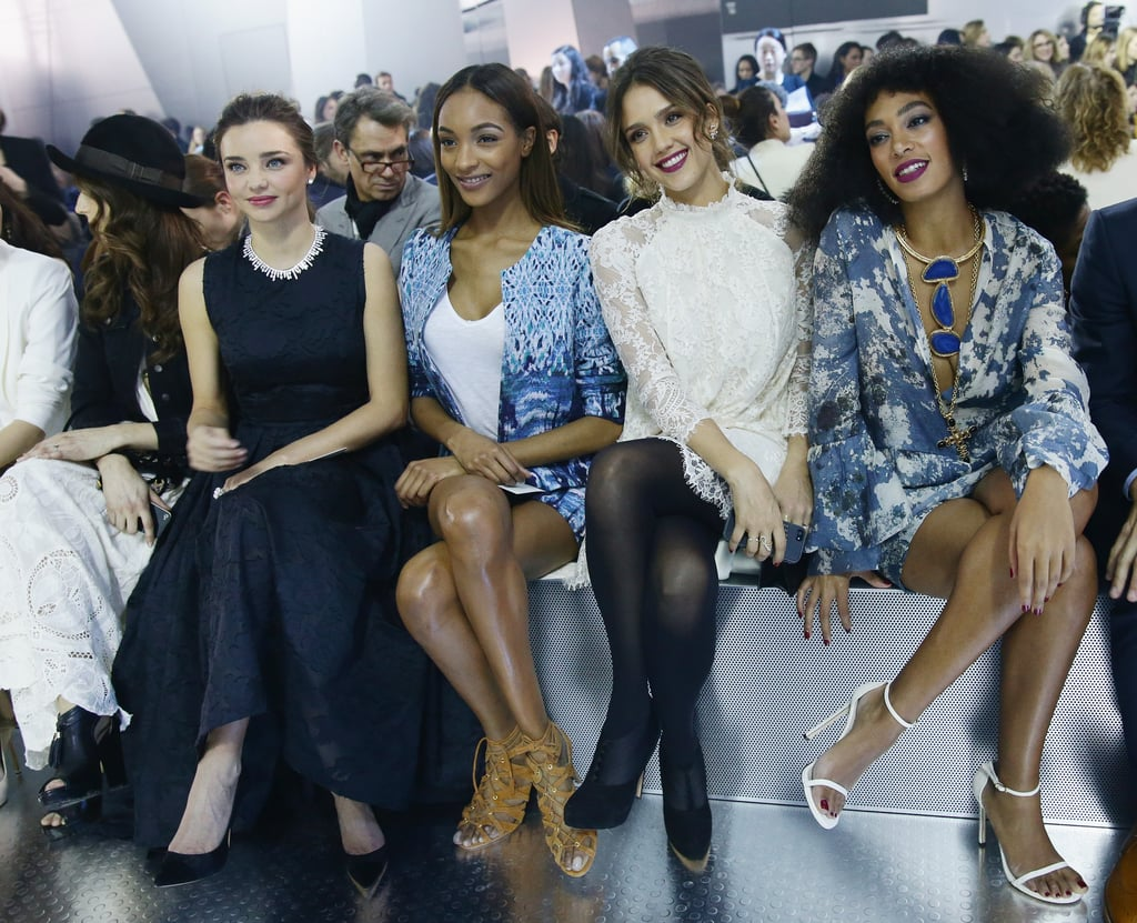 """Paris Fashion Week is in full swing overseas, and Wednesday's H&M show brought a handful of our favorite stars together. Miranda Kerr sat front row with Jessica Alba, Solange Knowles, Pretty Little Liars star Troian Bellisario, and model Jourdan Dunn, all posing pretty as they watched the action on the runway. Troian, who just got engaged to Suits star Patrick J. Adams, showed off her gorgeous engagement ring after the show, but she wasn't the only one flashing her bling. Olivia Palermo's stunning diamond was in full view as she cozied up with her fiancé, Johannes Huebl, and Jessica Alba's own ring sparkled as she flashed a thumbs up at the show. Selfies were also a big hit, with Jessica spotted snapping one in the front row, and Miranda sharing a cute pic. Troian later posted one with the model, too, writing, """"Thanks for sharing the bench. So nice to meet you, beautiful.""""  Source: Getty"""
