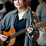 Keira Knightley spends a day on set playing guitar.