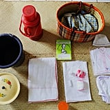 Razafindrabary's bag included new clothes, cotton wool, alcohol for cleaning, diapers, a thermos, a bucket, sanitary pads, a booklet, and a basket.