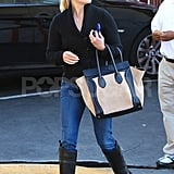 Reese Witherspoon in riding boots.