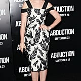 Lily Collins's red satin Brian Atwood pumps speak perfectly to her retro-inspired glamour and complement the beautiful black and white print Marc Jacobs frock.