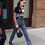 In May 2018, she stepped out with her go-to bag in New York City, pairing it with a patriotic sweater and gray jeans.