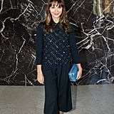 Rashida Jones played with proportions in cropped trousers at the Miu Miu Spring 2014 show then got bold with her Miu Miu accessories, including a bright blue clutch and platform Mary Janes.