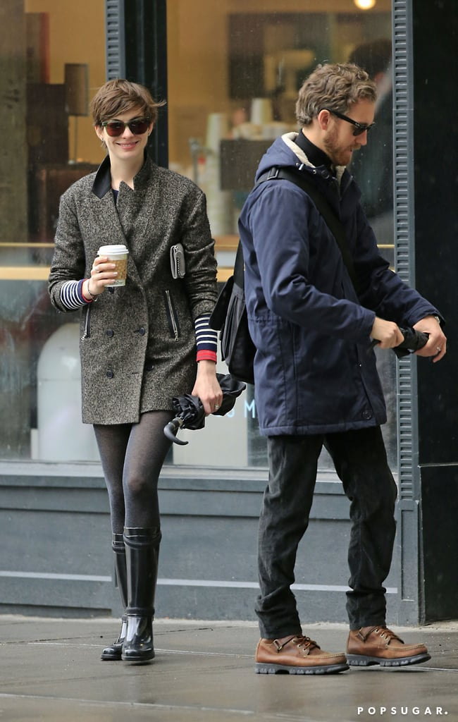 Anne Hathaway and Adam Shulman braved the NYC rain for a coffee stop yesterday. They brought their umbrellas along for their latest couple's outing after showing PDA in the city earlier this month. Anne is winding down on the East Coast following a busy award season, which culminated with her Oscar win for best supporting actress. She did fit in another celebration recently, though, at the opening night of her mom Kate McCauley's play Ann last Thursday. It was a Hathaway family affair, as Anne's two brothers, Michael and Thomas Hathaway, and her father, Gerald Hathaway, joined in on the special occasion as well.