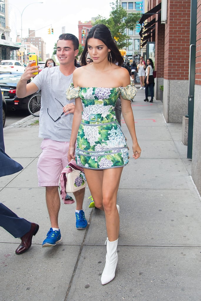 Kendall Jenner's headed to the Veuve Clicquot Polo Classic, and, of course, she found the perfect little Spring dress to arrive in. The star wore an off-the-shoulder floral ensemble by Dolce & Gabbana with a slightly flared hem and matching belt, which were small nods to the mod style. Kendall even ditched her heels for a pair of white ankle boots. It seems her outfit stopped traffic as fans ran after her on the street. We don't blame them though. We would chase after Kendall too if we spotted her in the floral dress.      Related:                                                                                                           Kendall Jenner Is Single-Handedly Making the Waist Bag a Thing in 2017