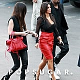 Kim Kardashian wore a red skirt.