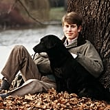 A young Prince Edward posed with his Black Labrador, Frances, in the grounds of Buckingham Palace back in 1982.