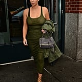 Armed in all green, Kim's look was streamlined. She added lace-up heels in an understated brown (read: not flashy metallics or a bright color) to complete the look.