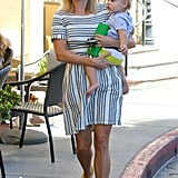 Reese Witherspoon wore a striped dress for an outing with baby Tennessee.
