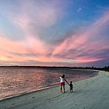 The mother and son took in a beautiful sunset.