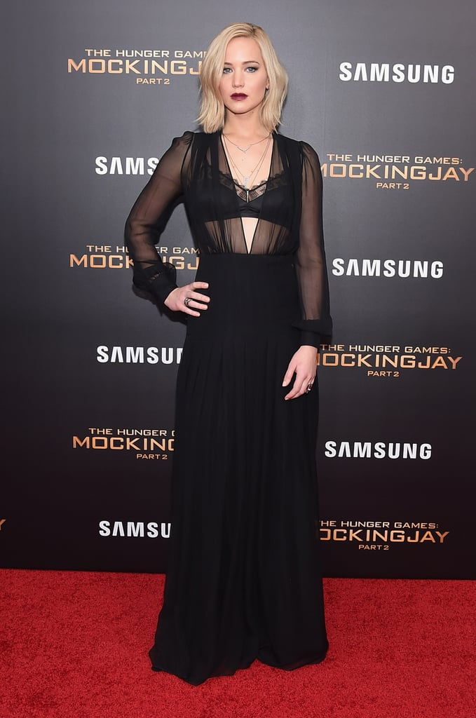 Jen daringly bared her lingerie when she wore a sheer Schiaparelli look to The Hunger Games: Mockingjay Part 2 premiere in New York. She layered on dainty Eva Fehren jewels and chose Tamara Mellon pumps.