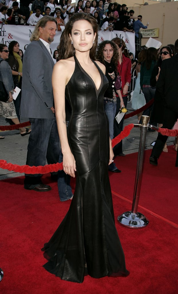 At the premiere of Mr & Mrs Smith wearing another Versace gown.