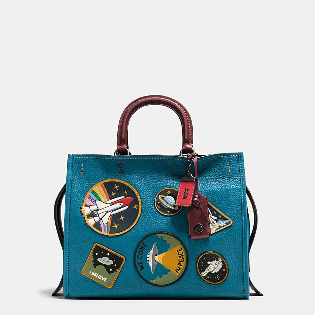 """If you love all things space, you'll flip over Coach's new limited-edition NASA collection. The brand recently launched the intergalactic """"Coach Space"""" collection inspired by """"American dreamers and explorers who believe that anything is possible,"""" and it's safe to say we're obsessed. Keep reading to see our top seven must-have items from Coach's out of this world NASA collection ahead."""
