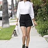 High-waisted shorts and a button-down shirt
