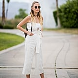 A white jumpsuit with coordinated sandals is ideal for light Summer style.