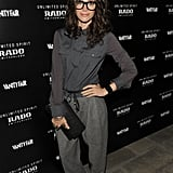 Her slouchy drawstring trousers are comfy-chic.