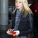 Emma Stone Zips Off to Her Next Destination