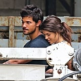 Taylor Lautner continued to cozy up to costar Marie Avgeropoulos on the NYC set of Tracers on Saturday.