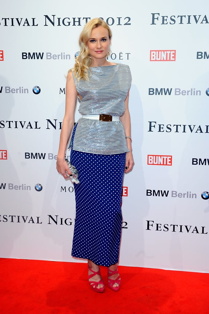 Diane Kruger wore a striped top and polka-dot skirt from the Alessandra Rich Spring collection in Berlin yesterday. She paired the prints with a fun jaguar clutch from Judith Leiber. Diane has brought out multiple fashionable looks during the Berlin Film Festival, including a dramatic Giambattista Valli and a unique 10 Crosby by Derek Lam skirt and dress combo. Her movie Farewell, My Queen is in the running for the festival's grand prize, the Golden Bear. Helping to decide which film takes home the top honor is Jake Gyllenhaal, who is a member of the jury. Also on hand for the German event are Angelina Jolie and Brad Pitt, since they stepped out to premiere In the Land of Blood and Honey together today.