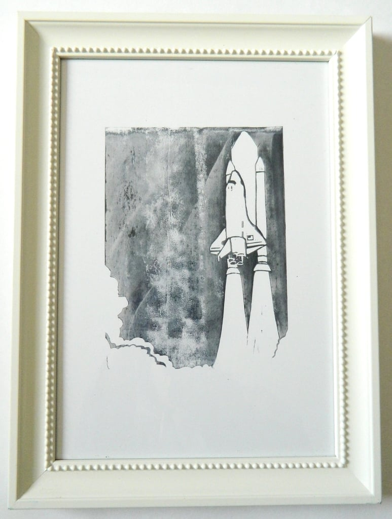 This Space Shuttle Linocut ($13) was hand-carved from a lino block and printed in deep blue.