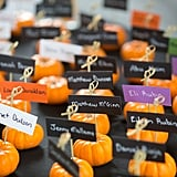 Instead of plain seat assignment cards, direct your guests with adorable mini pumpkins.