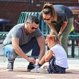 Jessica Alba watched as her husband, Cash Warren, tied little Honor's shoelace.