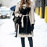 Snow doesn't mean you can't be sophisticated — take notes and add a water-resistant trench and sleek boots.