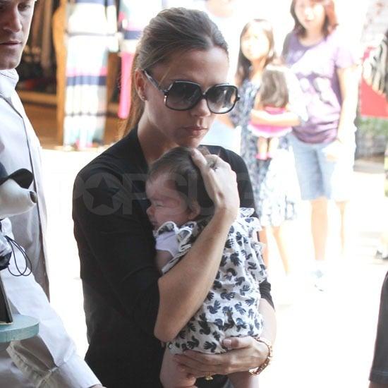 Victoria Beckham held little Harper close.