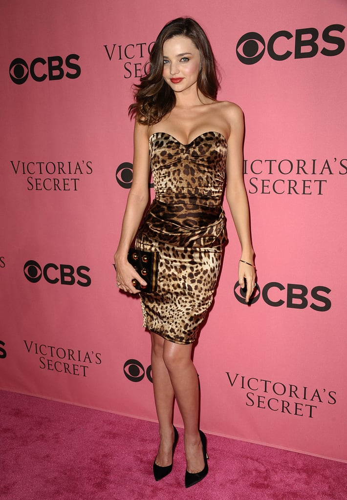 Miranda Kerr paired black pointy pumps with a Dolce & Gabbana leopard-print dress.