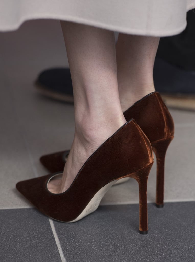 To finish her outfit, Meghan chose a pair of velvet Jimmy Choo pumps.