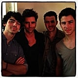 What, like we're not going to share this picture of John Stamos hanging out with the Jonas brothers? Come on. Source: Instagram user johnstamos