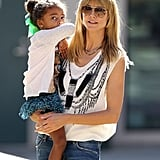 Heidi Klum held her daughter Lou during a fun-packed day in LA that included a soccer game.