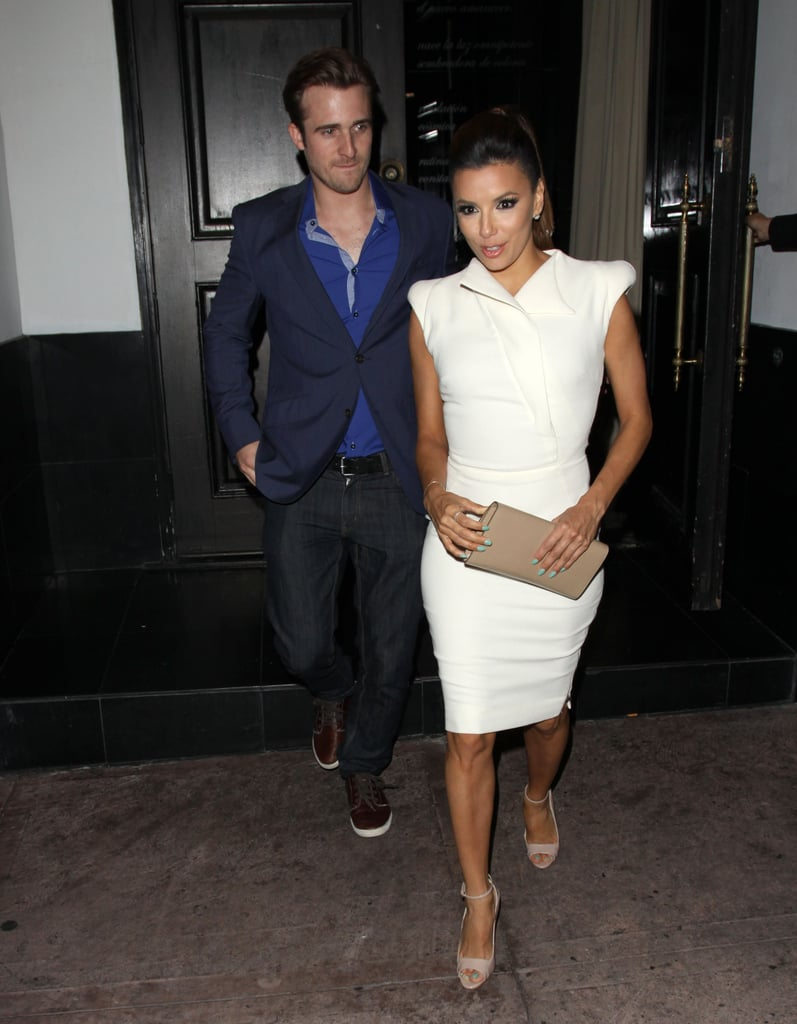 Eva Longoria showed off a sculptural white knee-length dress perfect for the bride-to-be with a little fashion-forward edge. Nude accessories coordinated without overpowering her look.