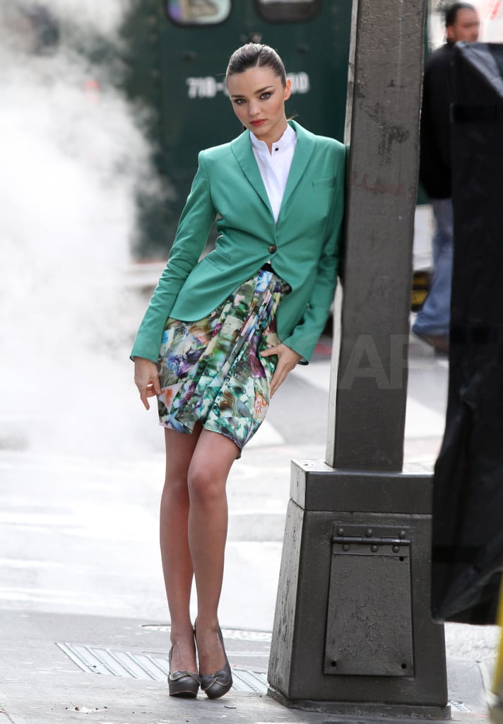 Miranda changed into a mint jacket and printed skirt for another shot.
