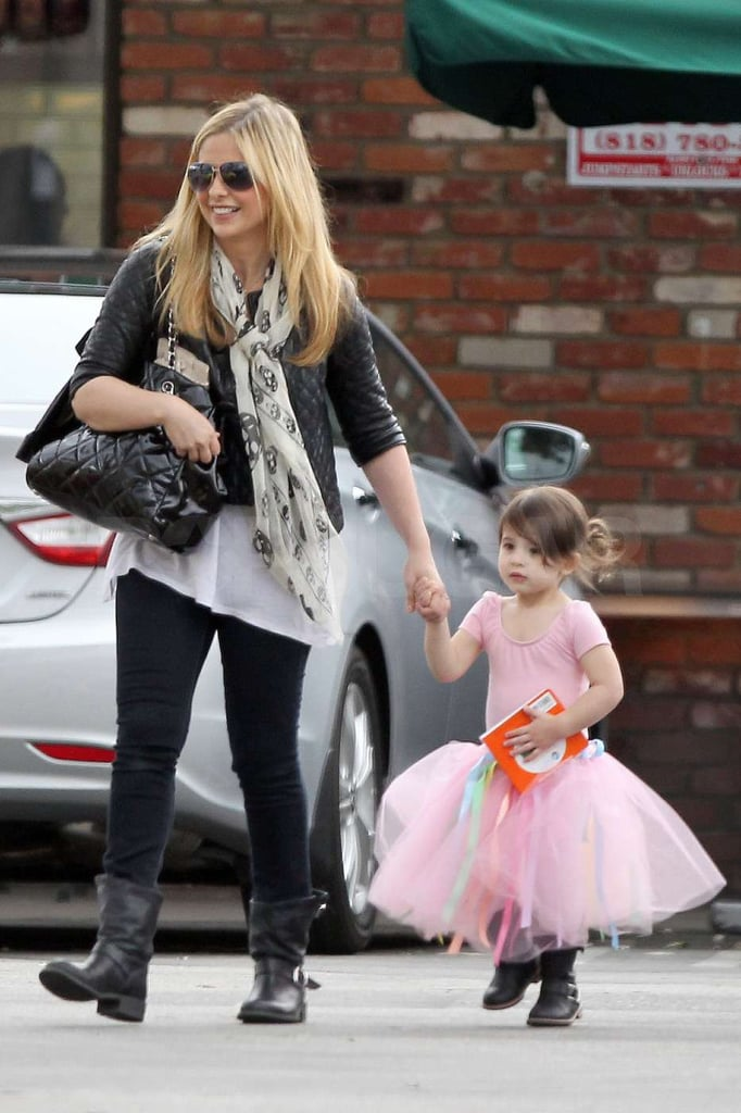 Sarah Michelle Gellar and Charlotte Prinze held hands as they headed to their car.