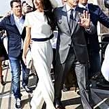 This Stella McCartney jumpsuit is one of our favorite looks on Amal. The navy ribbon at the waist and around her ultraglam wide-brim hat is transporting us to the French Riviera.
