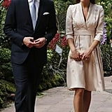 Kate Middleton looked radiant in a soft floral-printed kimono dress by Jenny Packham — the orchids on her dress went perfectly with the Singapore Botanic Gardens scenery.