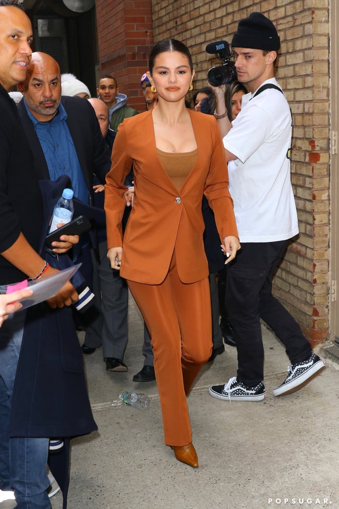 Selena Gomez Wearing a Burnt Orange Suit and Croc-Embossed Boots in NYC