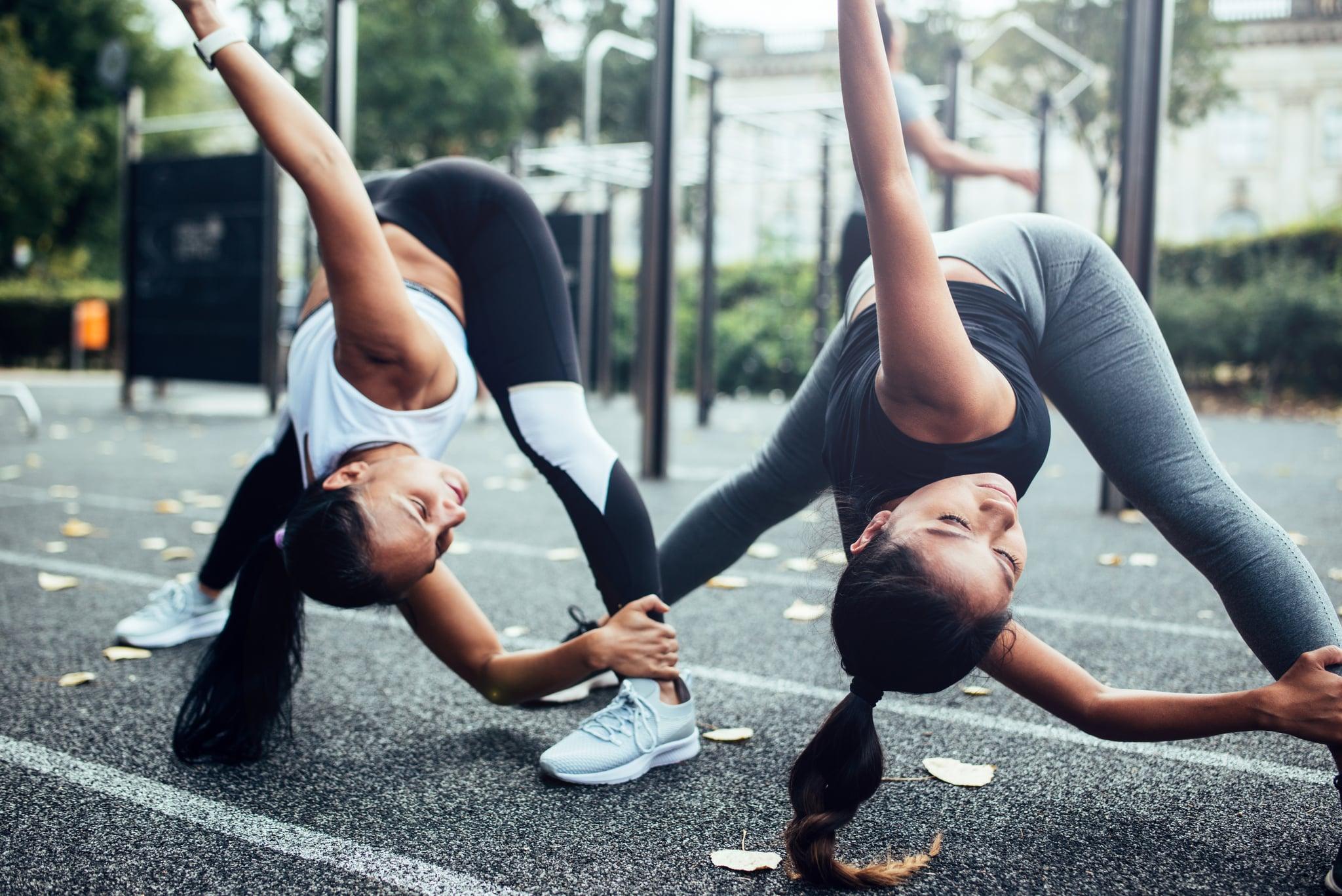 Women doing warm up before fitness training in Berlin.