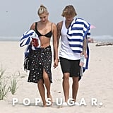 Hailey wore a classic black triangle bikini and a wrap skirt.