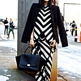 A sleek black blazer tempered bold graphic separates for a simultaneously subversive and chic look.