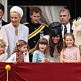 As the family gathered on the balcony, Kate leaned in to talk to the younger girls.