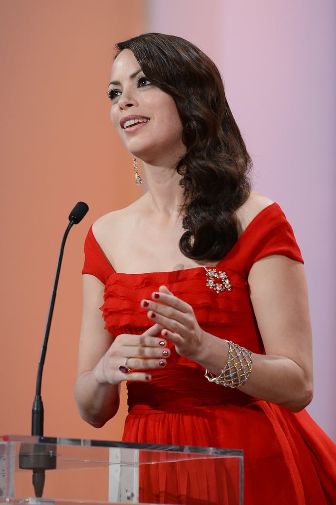 Bérénice Bejo adorned her Louis Vuitton dress with a brooch and wore a crystal-encrusted cuff, too.