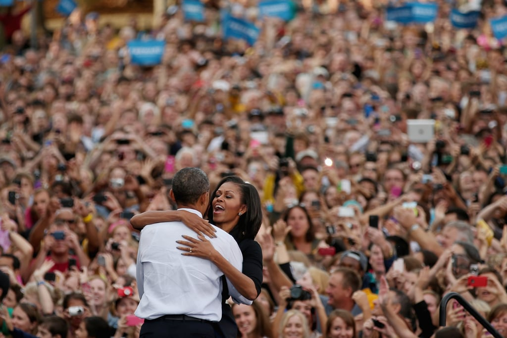 In September, Michelle gave Barack a big hug in Iowa City.
