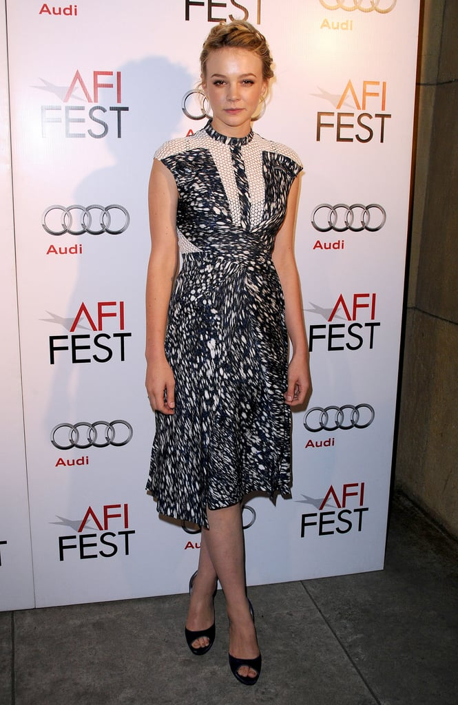 Carey Mulligan posed in a printed Peter Pilotto, with sheer lace detail, and blue peep-toe pumps during the AFI Fest in Hollywood.