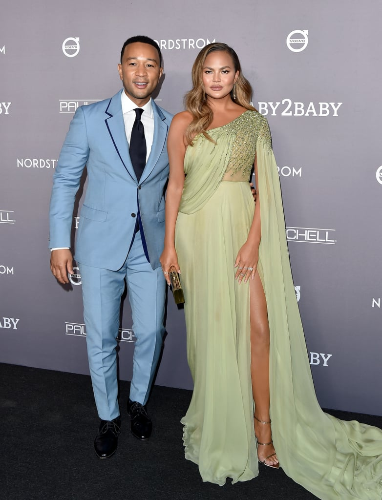 Chrissy Teigen looked like a gorgeous goddess in green at the 2019 Baby2Baby Gala in Culver City, CA, on Saturday night. The Cravings cookbook author was presented with an award for her philanthropic efforts by her husband, John Legend, and the cute couple were the picture of pastel perfection on the red carpet. John even made sure her train didn't get trampled while they posed for photos together.  For the special occasion, Chrissy chose a Georges Hobeika one-shoulder gown from the designer's Fall/Winter 2019-20 collection. The dress features delicate beading with a thigh-high slit, a flowing skirt, and a draping sleeve. She tied the look together with Jennifer Meyer jewelry and metallic heeled sandals, which made way for the ultimate red carpet glow. Ahead, see more photos of Chrissy's whole ensemble from her night on the red carpet.       Related:                                                                                                           The Most Iconic Dresses in Red Carpet History