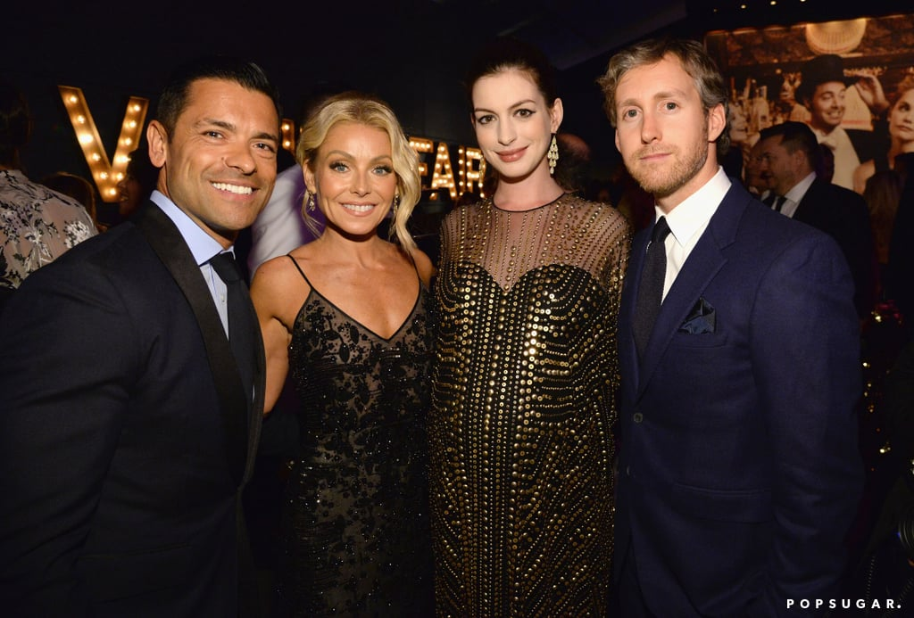Pictured: Anne Hathaway, Kelly Ripa, Mark Consuelos, and Adam Shulman