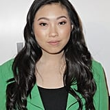 The texture and shine in Awkwafina's jet black hair gives her look serious edge and sex appeal.