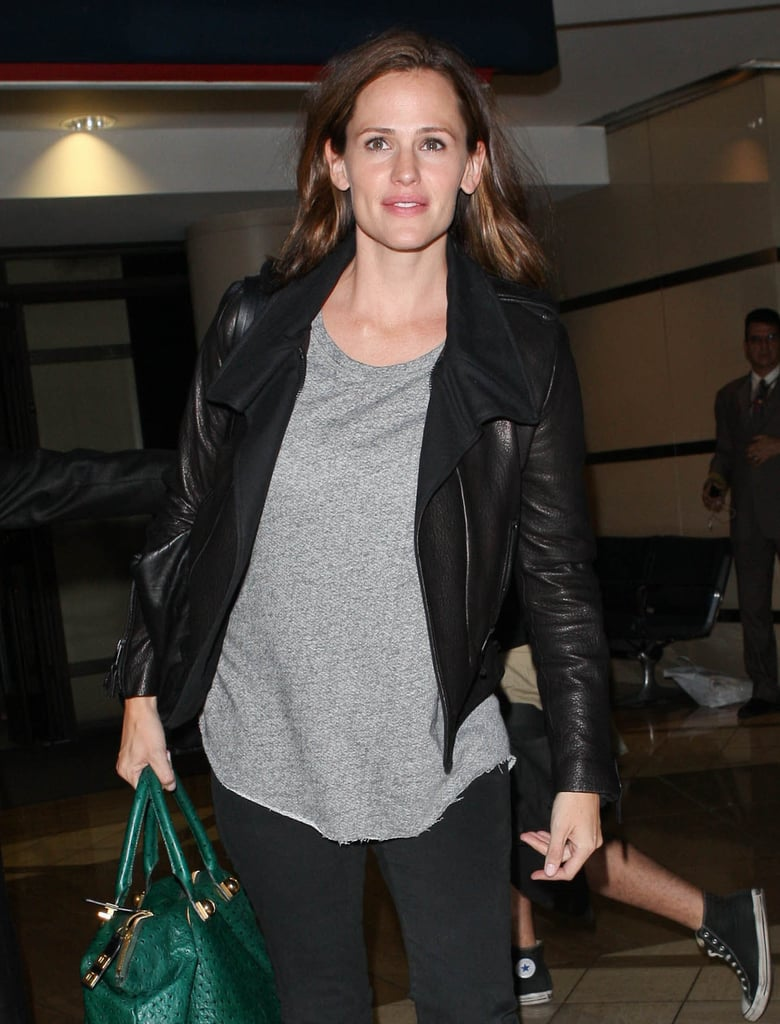 Jennifer Garner wore a gray t-shirt under a black leather jacket.